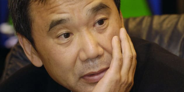 Japanese author Haruki Murakami listens to a question during an interview upon his arrival at Prague airport Ruzyne on Sunday, Oct. 29, 2006. Haruki Murakami, 57, is one of the outstanding contemporary Japanese writers. He gained popularity in Japan and worldwide with his novel Norwegian Wood. Murakami, one of the candidates for the Nobel Prize for Literature this year, will be awarded the Franz Kafka Prize at the Old Town Hall in Prague on Monday. (AP Photo/CTK, Stan Peska) ** SLOVAKIA OUT **