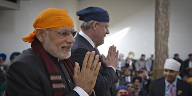 India's Prime Minister Narendra Modi  (L) and Canada's Prime Minister Stephen Harper (R) walk together during a visit to the Gurdwara Khalsa Diwan in Vancouver, British Columbia, April 16, 2015. Modi is on an official visit to Canada.   AFP PHOTO / Pool / ANY CLARK        (Photo credit should read ANDY CLARK/AFP/Getty Images)