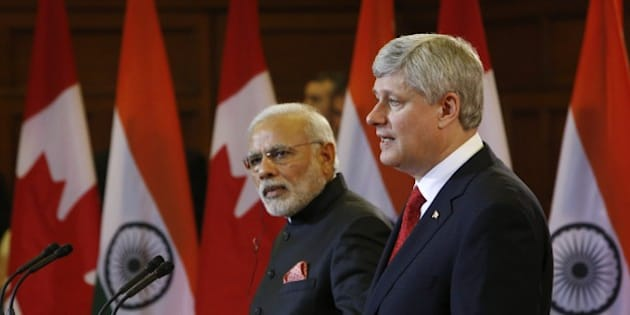 Canada's Prime Minister Stephen Harper speaks alongside India's Prime Minister Narendra Modi (L) during a joint press conference on Parliament Hill  in Ottawa, Canada on April 15, 2015. Prime Minister Modi will continue his official visit to Canada in Toronto and Vancouver. AFP PHOTO/ COLE BURSTON        (Photo credit should read Cole Burston/AFP/Getty Images)