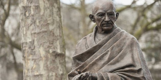 A recently unveiled statue of Mahatma Gandhi is seen in Parliament square in central London on March 14, 2015. A statue of Indian independence leader Mahatma Gandhi was unveiled on Saturday at the symbolic heart of the British establishment that once loathed him for his campaign against imperial rule. Gandhi joins figures including Britain's World War II leader Winston Churchill, who described him as a half-naked 'fakir', in London's Parliament Square, opposite Big Ben and the House of Commons. AFP PHOTO / NIKLAS HALLE'N        (Photo credit should read NIKLAS HALLE'N/AFP/Getty Images)