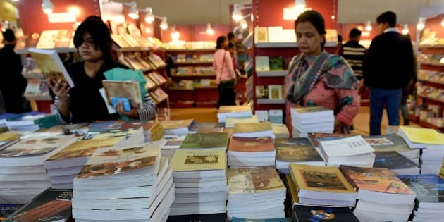 Indian visitors browse at a stall at the World Book Fair in New Delhi on February 16, 2015. The New Delhi World Book Fair (NDWBF) is organised by the National Book Trust of India and runs from 14 - 22 February, 2015. AFP PHOTO / MONEY SHARMA        (Photo credit should read MONEY SHARMA/AFP/Getty Images)