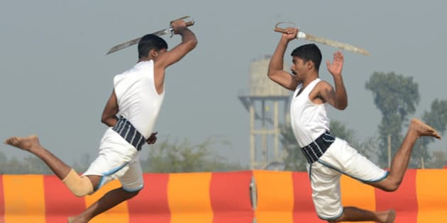 Indian soldiers perform the Indian martial art Kalaripayattu during an Army Mela (fair) and exhibition at Khasa, some 15 kms from Amritsar, on December 17, 2012. The Army Mela (fair ), organised by the Vajra Corps, displayed weapons, tanks, aircraft and military equipment to students and civilian visitors of the event. AFP PHOTO/ NARINDER NANU        (Photo credit should read NARINDER NANU/AFP/Getty Images)