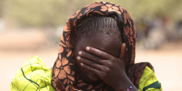 In this photo taken Saturday, Jan. 31, 2015. Dorcas Aiden, 20 years old , speaks to a journalist in Yola, Nigeria. Dorcas Aiden was another of the girls caught in Boko Haram's siege. She had finished high school and was living at home when the war came to her village. Fighters took her to a house in the town of Gulak and held her captive for two weeks last September. The more than 50 teenage girls crammed into the house were beaten if they refused to study Quranic verses or conduct daily Muslim prayers, she says. When the fighters got angry, they shot their guns in the air. Aiden finally gave in and denied her Christian faith to become Muslim, at least in name, she says. (AP Photo/Lekan Oyekanmi)