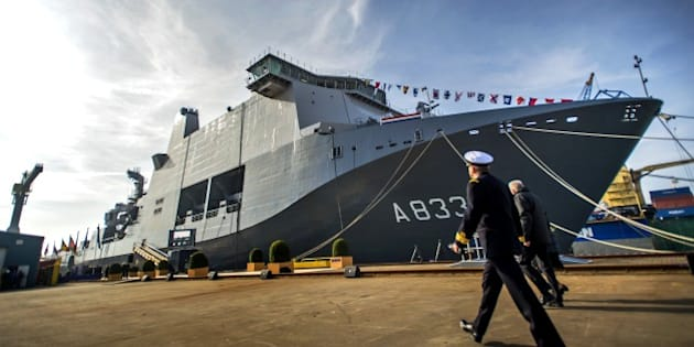 An navy officer walks next to the ship 'Karel Doorman' of the Royal Netherlands Navy in Ritthem, near Middelburg, on March 8, 2014, during the ship's christening. The Karel Doorman is a multi-function support ship of the Royal Netherlands Navy, used for amphibious operations. AFP PHOTO / ANP / REMKO DE WAAL   **NETHERLANDS OUT**        (Photo credit should read REMKO DE WAAL/AFP/Getty Images)