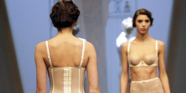 A model presents underwear creations during a show at the International Lingerie Fair (Salon de la lingerie) on January 24, 2015  in Paris. AFP PHOTO / KENZO TRIBOUILLARD        (Photo credit should read KENZO TRIBOUILLARD/AFP/Getty Images)