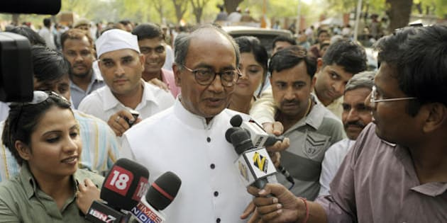 Congress Party General Secretary Digvijay Singh is surrounded by journalists as he exits Congress Party President Sonia Gandhi's residence in New Delhi on May 16, 2009, during the vote counting process. India's ruling Congress-led alliance swept to a commanding election victory on May 16, crushing its Hindu nationalist rivals and setting up a second term for Prime Minister Manmohan Singh. With results still coming in from the Election Commission, the Congress grouping was on track to win around 250 seats against 160 for the main opposition bloc headed by the Bharatiya Janata Party (BJP). AFP PHOTO/ Manpreet ROMANA (Photo credit should read MANPREET ROMANA/AFP/Getty Images)