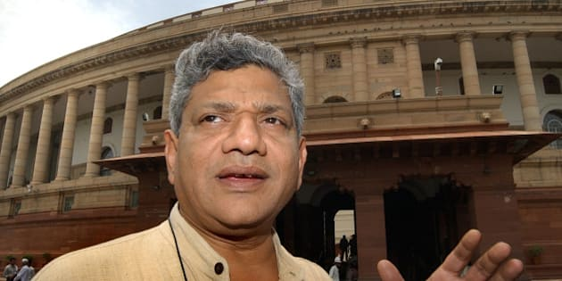 Communist Party of India (Marxist) leader Sitaram Yechury speaks to the media outside the Indian parliament in New Delhi, India, Tuesday, May 23, 2006. The Indian Parliament closed Tuesday after the summer session. (AP Photo/Ajit Kumar)