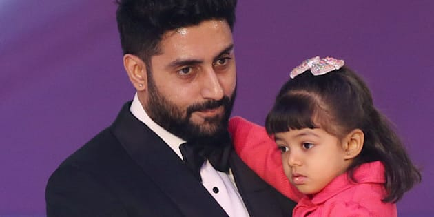 Abhishek Bachchan and daughter Aaradhya Bachchan, during the Miss World 2014 final, on stage at the Excel centre in east London, Sunday, Dec. 14, 2014. (Photo by Joel Ryan/Invision/AP)