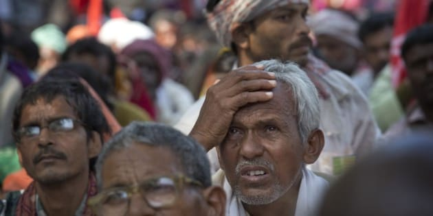 An Indian farmer listens to a speaker as they gather near the parliament for a protest against the land acquisition bill, in New Delhi, India, Monday, March 16, 2015. The bill currently in parliament proposes to ease rules for acquiring land to facilitate infrastructure projects. (AP Photo / Manish Swarup)