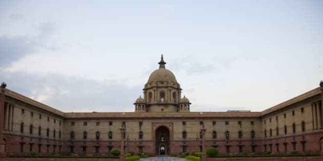 Sir Edwin Lutyen, British architect and visionary, was called upon to design a new capital for the British rulers of India. His brief was unambiguous, the new capital should match, if not improve upon, the grandeur and vastness of the world's best cities, yet capitalize on the intricacy of the Indian architecture. 2800 acres of land was carved outside the old city, away from the hustle and bustle of Chandni Chowk and the ramparts of the Red Fort.  With a free hand to draw as he pleased, Lutyen sketched out the flowing lines of New Delhi - the Rashtrapati Bhavan (President's House), the Parliament, the magnificent drive or Raj Path from the President's house to the India Gate and the Canopy beyond for the statue of King George.  Offices of the British Resident, the North and the South Blocks, flanking the side of the Rashtrapati Bhavan melted into the buildings that housed the local administration. Deep set and overlooking the large greens dotted with small streams and fountains and planted with the saplings of the shade-giving and water-conserving Jamun tree, the gracious India Gate lawns were regal in their splendour.
