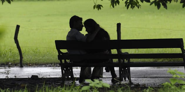 An Indian couple sit on a bench near the Victoria Memorial complex on Friendship Day in Kolkata on August 1, 2010.  Friendship Day celebrations take place on the first Sunday of August every year. The tradition of dedicating a day in honour of friends began in the US in 1935.  AFP PHOTO/Deshakalyan CHOWDHURY (Photo credit should read DESHAKALYAN CHOWDHURY/AFP/Getty Images)