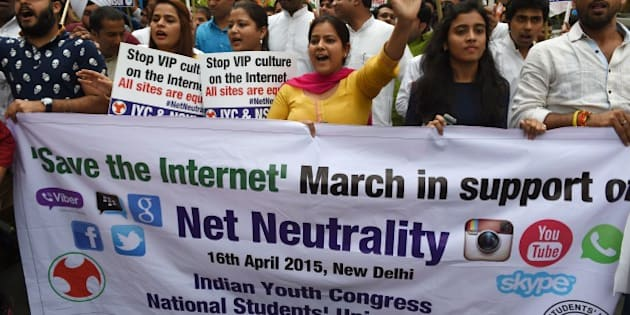 Activists of Indian Youth Congress and National Students Union of India shout anti-government slogans during a protest in support of net neutrality in New Delhi on April 16, 2015.   India's largest e-commerce portal Flipkart on April 14 scrapped plans to offer free access to its app after getting caught up in a growing row over net neutrality, with the criticism of Flipkart feeding into a broader debate on whether Internet service providers should be allowed to favour one online service over another for commercial or other reasons -- a concept known as 'net neutrality'.   AFP PHOTO / MONEY SHARMA        (Photo credit should read MONEY SHARMA/AFP/Getty Images)