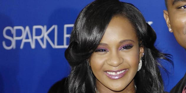 """Photo by: GP/STAR MAX/IPx 8/6/12 Bobbi Kristina Brown, Whitney Houston's 21-year-old daughter, was """"fighting for her life"""" and surrounded by loved ones in a hospital Monday, her family said — two days after she was found face down and unresponsive in a bathtub at her Georgia home. In this picture she is seen at the premiere of Tri Star Pictures SPARKLE, held at Grauman's Chinese Theatre, on August 16, 2012, in Los Angeles."""