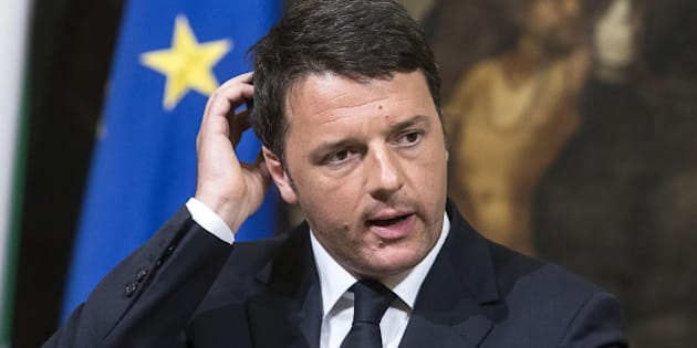 "Italian premier Matteo Renzi talks to journalists during a press conference he held after a meeting with his top ministers in an emergency strategy session, in Rome, Sunday, April 19, 2015. A crowded fishing boat that one survivor said carried 700 migrants capsized north of Libya overnight, and only a few dozen people were rescued Sunday, raising fears that it could become the Mediterranean's deadliest known migrant sea disaster. Renzi sayd officials are ""not in a position to confirm or verify"" that the boat had 700 people aboard, as one survivor told rescuers, but said that so far there were 28 survivors and 24 dead. (Angelo Carconi/ANSA via AP) ITALY OUT"