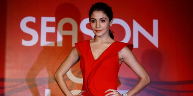 Bollywood actress Anushka Sharma poses for photos during a promotional event of a jewelry in Mumbai, India, Thursday, Jan. 24, 2013. (AP Photo/Rafiq Maqbool)