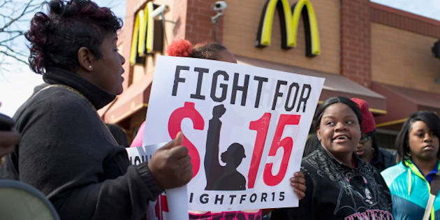 CHICAGO, IL - APRIL 15:  Demonstrators gather in front of a McDonald's restaurant to call for an increase in minimum wage on April 15, 2015 in Chicago, Illinois. The demonstration was one  of many held nationwide to draw attention to the cause.  (Photo by Scott Olson/Getty Images)