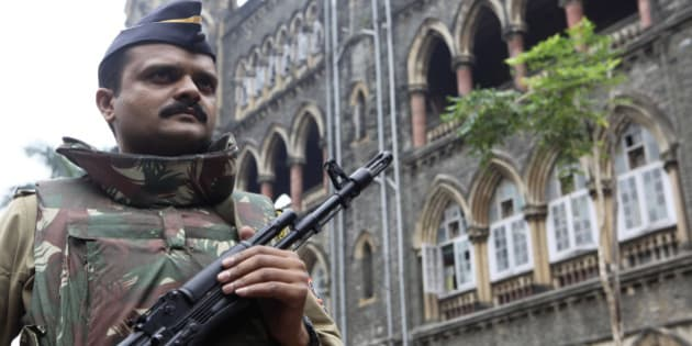 An Indian policeman patrols outside the Mumbai High Court in Mumbai, India, Monday, Oct. 18, 2010. The court began hearing an appeal Monday by the only surviving gunman from the deadly 2008 Mumbai attacks against the death sentence awarded to him by a trial court. (AP Photo/Rafiq Maqbool)