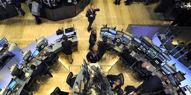 (FILES) File photograph dated May 6, 2010 shows traders on the floor of the New York Stock Exchange looking at stocks during the final minutes of trading as the Dow Jones lost almost 1,000 points before recovering to a loss of 505. The Wall Street 'flash crash' on May 6 that saw the Dow Jones index dive 700 points within minutes was sparked by a single 4.1-billion-dollar computer trade, US watchdogs said October 1, 2010. The historic crash was prompted by one firm's algorithm selling off 75,000 stocks in 20 minutes, according to a joint report by the Securities and Exchange Commission (SEC) and the US Commodity Futures Trading Commission (CFTC). Amid tense market conditions the sale started a cascade of automated sales, the report said.  AFP PHOTO/TIMOTHY A. CLARY (Photo credit should read TIMOTHY A. CLARY/AFP/Getty Images)