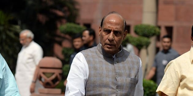 Indian Home Minister Rajnath Singh leaves after a Bharatiya Janata Party (BJP) parliamentary committee meeting at parliament in New Delhi on April 21, 2015.  The Land Acquisition Ordinance was tabled amid opposition protest in Lok Sabha on April 20.  AFP PHOTO / PRAKASH SINGH        (Photo credit should read PRAKASH SINGH/AFP/Getty Images)
