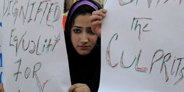 Kashmiri students hold placards and banners during protest in Srinagar on January 10, 2013. The students demonstrated against the recent acid attack on a 28-year-old woman in Srinagar. AFP PHOTO/Rouf BHAT        (Photo credit should read ROUF BHAT/AFP/Getty Images)