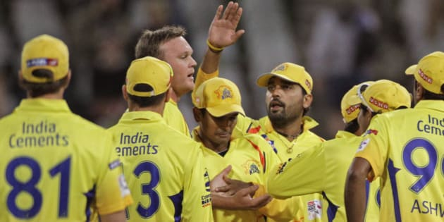 Chennai Super Kings Faf du Plessis, second left, reacts with team members as they take the wicket of Highveld Lions' Quinton de Kock, unseen, during a Champions League Twenty20 in Cape Town, South Africa, Tuesday, Oct 16, 2012. (AP Photo/Schalk van Zuydam)