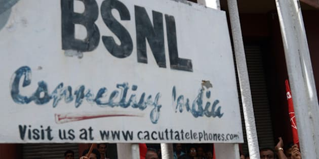 Employees of the state-run Bharat Sanchar Nigam Limited (BSNL) shout anti-government slogans at the BSNL office in Kolkata on July 17, 2013. The employees were protesting against the recent government decision to open the doors of greater foreign investments in almost a dozen sectors including telecom and defence. AFP PHOTO/Dibyangshu SARKAR        (Photo credit should read DIBYANGSHU SARKAR/AFP/Getty Images)