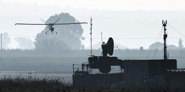 A picture shows an Israeli army UAV landing in an airfield, in the Israeli-annexed Golan Heights, on January 20, 2015, two days after an Israeli air strike killed six Hezbollah members in the Syrian-controlled side of the Golan Heights. The strike on Syria killed an Iranian general, Tehran confirmed on January 19, as thousands of supporters of Lebanon's Hezbollah gathered to bury one of the six fighters killed in the same raid. AFP PHOTO / JACK GUEZ        (Photo credit should read JACK GUEZ/AFP/Getty Images)