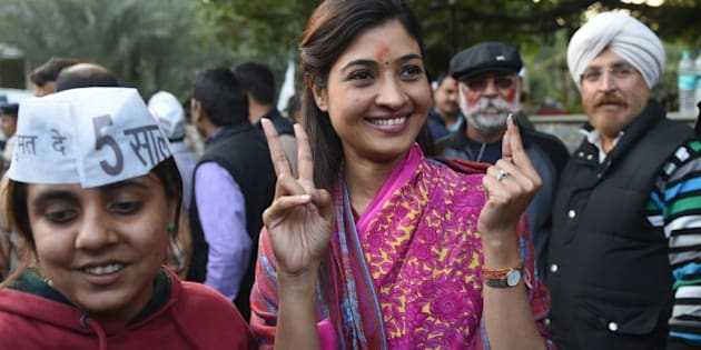 Senior Leader of India's Aam Aadmi Party (AAP) Alka Lamba (C) gestures as she arrives for a meeting in New Delhi on February 10, 2015.  India's Narendra Modi suffered his first major election setback since becoming prime minister last May, as anti-corruption campaigner Arvind Kejriwal won a landslide victory in Delhi state polls.  AFP PHOTO / SAJJAD HUSSAIN        (Photo credit should read SAJJAD HUSSAIN/AFP/Getty Images)