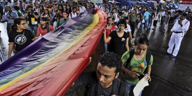 Lesbian, Gay, Bisexual and Transgender (LGBT) activists hold a rainbow flag as they participate in the Rainbow Pride Rally in Kolkata, India, Sunday, July 13, 2014. (AP Photo/Bikas Das)