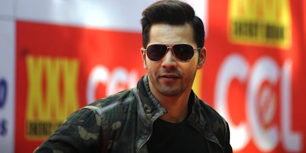 Indian Bollywood actor Varun Dhawan poses for a photograph during the Celebrity Cricket League (CCL) season five in Mumbai on January 10, 2015. AFP PHOTO / STR        (Photo credit should read STRDEL/AFP/Getty Images)