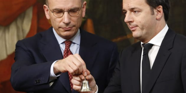 Italian outgoing Premier Enrico Letta, left, hands over the cabinet minister bell to new Premier Matteo Renzi during the handover ceremony at Chigi Palace Premier's office, in Rome, Saturday, Feb. 22, 2014. Renzi has been sworn in as Italy's youngest premier, heading a new government he says promises will swiftly tackle old problems. Renzi had been serving as Florence mayor when he engineered a power grab last week to effectively force fellow Democrat, Enrico Letta, to step down after 10 months at the helm of a fragile, often-squabbling coalition. (AP Photo/Riccardo De Luca)