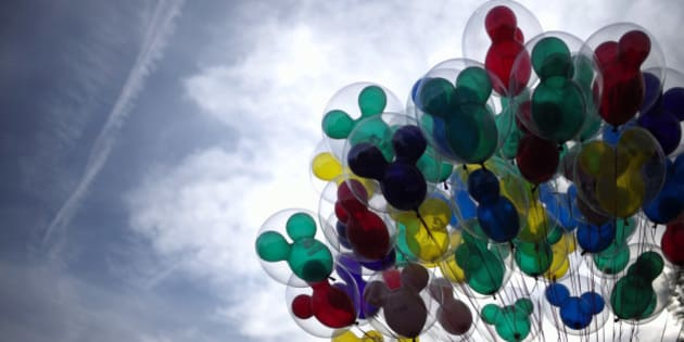 Mickey Mouse shaped balloons are for sale at Disneyland, Thursday, Jan. 22, 2015, in Anaheim, Calif. A major measles outbreak traced to Disneyland has brought criticism down on the small but vocal movement among parents to opt out of vaccinations for their children. (AP Photo/Jae C. Hong)