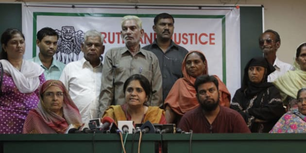 Citizens for Justice and Peace (CJP) founder Teesta Setalvad, center, addresses a press conference as riot victims look on during the release of selected tapes of a sting operation in Ahmadabad, India, Monday, March 22, 2010. The sting operation allegedly shows the direct and indirect role of Gujarat state Chief Minister Narendra Modi in the 2002 unrest between Hindus and Muslims that killed more than 1,000 people. CJP is a private group working with riot victims. (AP Photo/Ajit Solanki)