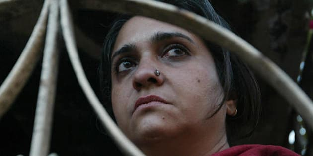 Indian human rights activist Teesta Setalvad listens as residents of The Gulbarg Society describe events in Ahmedabad, 16 February 2008, atthe scene of one of the worst massacres in the 2002 post-Godhra riots where 70 people were killed by a mob.   The Sabrang Trust and Citizens for Justice and Peace are spearheading an effort to raise funds to buy the buildings from their present owners and convert the buildings into a museum. At least 2,000 Muslims were hacked, beaten, shot or burnt to death in the riots, which erupted after 59 Hindu pilgrims died in a train fire first blamed on a Muslim mob, but which an inquiry later concluded was accidental. The state government has been accused of dragging its heels in prosecuting those accused in the riots. More than 4,250 cases were filed with state authorities but police dropped more than half, citing lack of evidence. AFP PHOTO/Sam PANTHAKY (Photo credit should read SAM PANTHAKY/AFP/Getty Images)