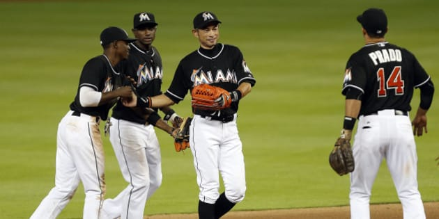 MIAMI, FL - APRIL 25: Ichiro Suzuki #51 of the Miami Marlins celebrates with teammates after breaking the record for the most runs scored by a Japanese player and their win against the Washington Nationals  at Marlins Park on April 25, 2015 in Miami, Florida. (Photo by Eliot J. Schechter/Getty Images)