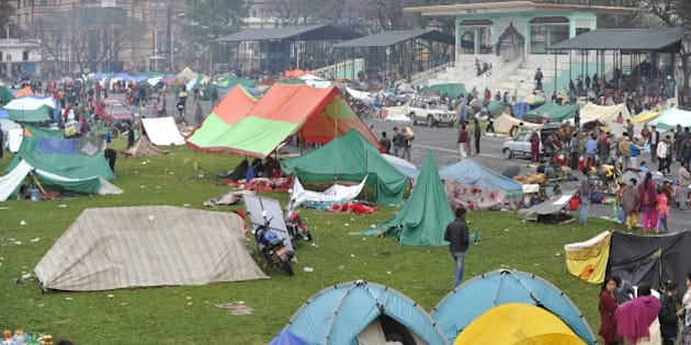 Nepalese people gather near temporary shelters set up in open areas of an Army ground in Kathmandu on April 27, 2015, two days after a 7.8 magnitude earthquake hit Nepal. International aid groups and governments intensified efforts to get rescuers and supplies into earthquake-hit Nepal on April 26, but severed communications and landslides in the Himalayan nation posed formidable challenges to the relief effort. AFP PHOTO / PRAKASH MATHEMA        (Photo credit should read PRAKASH MATHEMA/AFP/Getty Images)