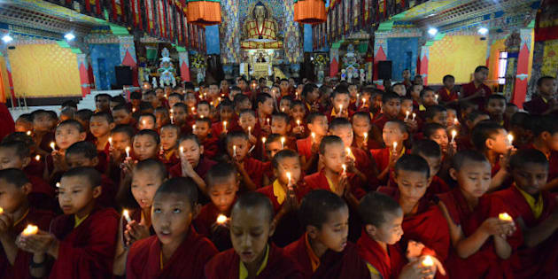 Novice Buddhist monks light candles and offer prayers for victims of Nepal's earthquake, in Bodhgaya, India, Sunday, April 26, 2015. Saturday's earthquake centered outside Kathmandu, the capital of Nepal, was the worst to hit the South Asian nation in over 80 years. It destroyed swaths of the oldest neighborhoods of Kathmandu, and was strong enough to be felt all across parts of India, Bangladesh, China's region of Tibet and Pakistan. (AP Photo/Manish Bhandari)