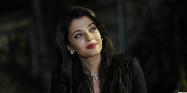 Indian Bollywood actress Aishwarya Rai Bachchan looks on during a photocall to mark her birthday in Mumbai on November 1, 2014. AFP PHOTO/STR        (Photo credit should read STRDEL/AFP/Getty Images)