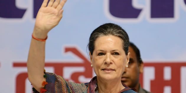 Indian Congress Party President Sonia Gandhi gestures as she addresses a rally held by the All Indian Women Congress in New Delhi on August 20, 2014. The congress is to hold a women's rally to mark former Indian Prime Minister Rajiv Gandhi's 70th birth anniversary.  AFP PHOTO/RAVEENDRAN        (Photo credit should read RAVEENDRAN/AFP/Getty Images)