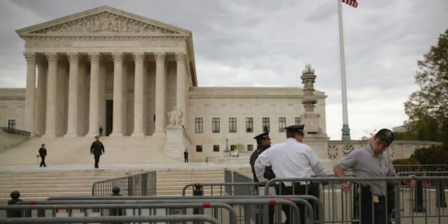 WASHINGTON, DC - APRIL 27: Police are setting up barracades before tomorrow's hearing on gay marriage at the U.S. Supreme Court April 27, 2015 in Washington, DC. The high court is scheduled to hear arguments April 28, in the case of Obergefell v. Hodges, that will ultimately decide whether states will still be allowed to ban same sex marriage and refuse to recognize the rights of couples married in other states.  (Photo by Mark Wilson/Getty Images)