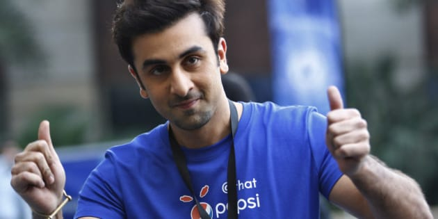 Indian Bollywood actor Ranbir Kapoor displays thumbs-up sign during a promotional event of soft drink major PepsiCo in Bangalore, India, Wednesday, Feb. 12, 2014. (AP Photo/Aijaz Rahi)