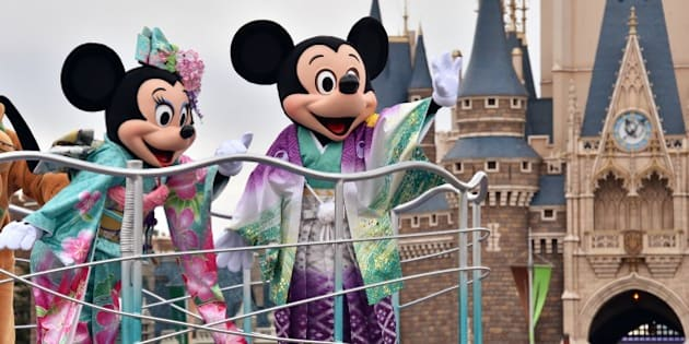 Disney characters Mickey (R) and Minnie Mouse (L), dressed in traditional Japanese kimonos, wave to greet guests from a float during the theme park's annual New Year's Day parade at Tokyo Disneyland in Urayasu, suburban Tokyo on January 1, 2015. The time around New Year's Day is one of the biggest holiday periods every year in Japan.        AFP PHOTO / Yoshikazu TSUNO        (Photo credit should read YOSHIKAZU TSUNO/AFP/Getty Images)