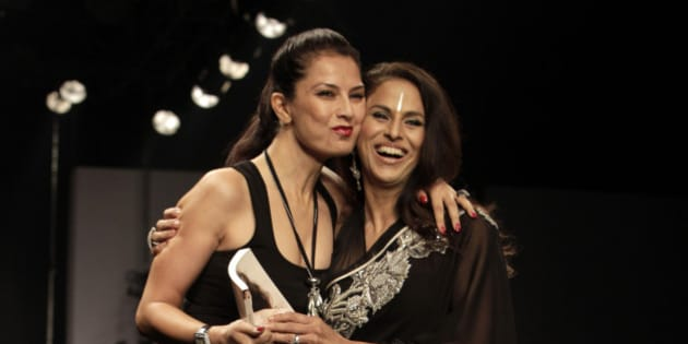 Indian designer Ritu Beri, left, hugs writer Shobha De after Beri's show during the Wills Lifestyle India Fashion Week, in New Delhi, India, Saturday, Oct. 23, 2010. (AP Photo/Manish Swarup)