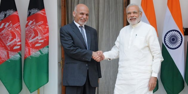 Afghan President Ashraf Ghani (L) shakes hands with Indian Prime Minister Narendra Modi in New Delhi on April 28, 2015. Ghani is on a three day visit to India.    AFP PHOTO/STR        (Photo credit should read STRDEL/AFP/Getty Images)