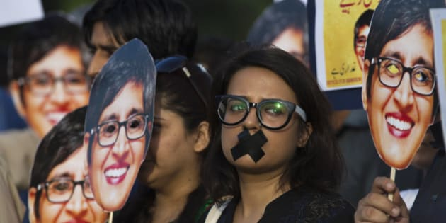 Supporters of prominent women's rights activist Sabeen Mahmud, who was killed by unknown gunmen, hold her pictures during a rally, Tuesday, April 28, 2015, in Islamabad, Pakistan. Gunmen on a motorcycle killed Mahmud last Friday in Pakistan just hours after she held a forum on the country's restive Baluchistan region, home to a long-running insurgency, police said. (AP Photo/B.K. Bangash)
