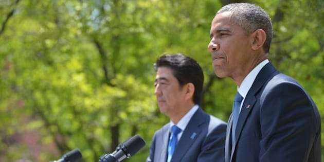 US President Barack Obama (R) pauses as he speaks during a joint press conference in the Rose Garden with Japan's Prime Minister Shinzo Abe on April 28, 2015 in Washington, DC. AFP PHOTO/MANDEL NGAN        (Photo credit should read MANDEL NGAN/AFP/Getty Images)