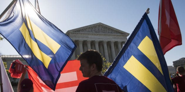 IMAGE DISTRIBUTED FOR HUMAN RIGHTS CAMPAIGN - Supporters of marriage equality gather outside the Supreme Court to demonstrate support for LGBT couples on Tuesday, April 28, 2015 in Washington. (Kevin Wolf/AP Images for Human Rights Campaign)