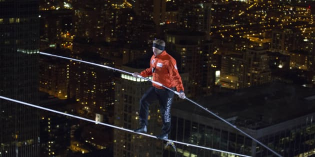 IMAGE DISTRIBUTED FOR DISCOVERY COMMUNICATIONS - Nik Wallenda walks over the Chicago River uphill nearly 8 stories for Discovery Channel's Skyscraper Live with Nik Wallenda on Sunday, Nov. 2, 2014. (Jean-Marc Giboux/AP Images for Discovery Communications)