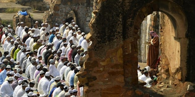 Indian Muslims offer Eid-al-Adha prayers among the ruins of the Feroz Shah Kotla mosque in New Delhi on October 6, 2014. Muslims across the world are preparing to celebrate the annual festival of Eid al-Adha, or the Festival of Sacrifice, which marks the end of the Hajj pilgrimage to Mecca and in commemoration of Prophet Abraham's readiness to sacrifice his son to show obedience to God. AFP PHOTO / CHANDAN KHANNA        (Photo credit should read Chandan Khanna/AFP/Getty Images)