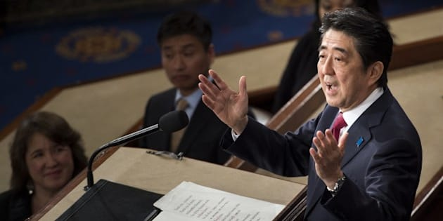 Japanese Prime Minister Shinzo Abe addresses a joint session of Congress at the US Capitol in Washington, DC, on April 29, 2015. AFP PHOTO/BRENDAN SMIALOWSKI        (Photo credit should read BRENDAN SMIALOWSKI/AFP/Getty Images)